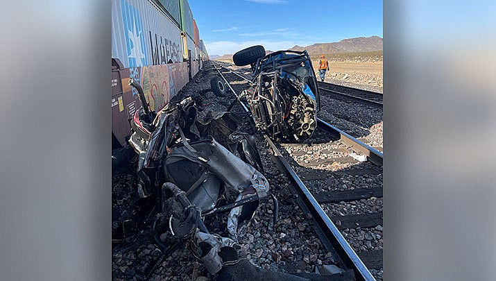 Three people were killed Sunday when two vehicles were struck by a train in Golden Valley. (MCSO photo)