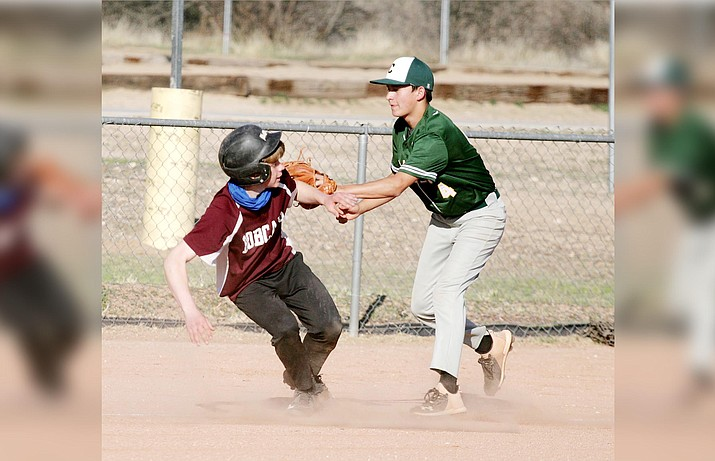 In a pickle between third base and home plate, Beaver Creek's Winter Cherry is tagged out by Clarkdale-Jerome's Xzayvier Buckner (No. 4) in a recent middle school baseball game at Beaver Creek School. VVN/Bill Helm