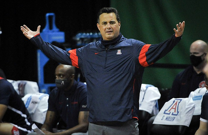 Arizona head coach Sean Miller questions a call during the second half of an NCAA college basketball game against Arizona in Eugene, Ore., in this Monday, March 1, 2021, file photo. Arizona has parted ways with men's basketball coach Sean Miller as the program awaits its fate in an NCAA infractions investigation, a person with knowledge of the situation told The Associated Press. The person told the AP on condition of anonymity Wednesday, April 7, 2021, because no official announcement has been made. (Andy Nelson, AP File)