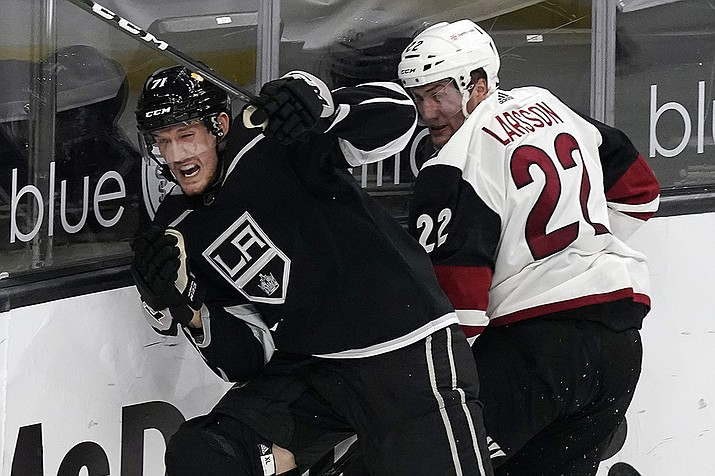 Los Angeles Kings defenseman Austin Strand, left, collides with Arizona Coyotes left wing Johan Larsson during the second period of an NHL hockey game Wednesday, April 7, 2021, in Los Angeles. (Marcio Jose Sanchez/AP)