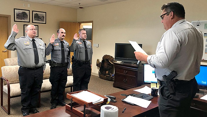 Mohave County Sheriff Doug Schuster swears in a new contingent of detention supervisors for the Mohave County Adult Detention Facility. From left are corporals Thomas Davidson and Cody Delgado, and Sgt. Cody Delgado. (MCSO photo)