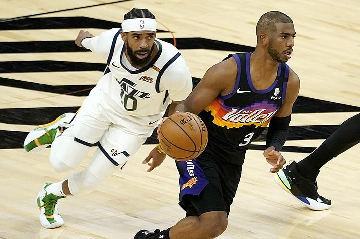 Phoenix Suns guard Chris Paul (3) drives as Utah Jazz guard Mike Conley (10) pursues during the first half of an NBA basketball game, Wednesday, April 7, 2021, in Phoenix. (Matt York/AP)