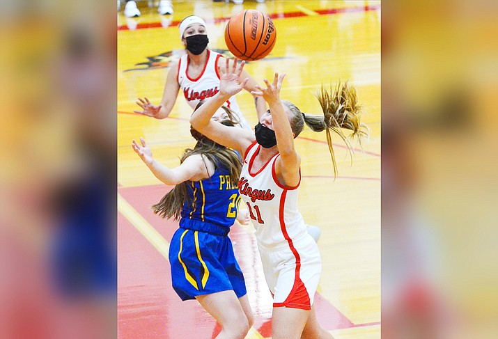 Mingus High School's Chayce Doerksen (No. 11), pictured, and Taylor Brock were named to the 4A Grand Canyon all-region second team for girls' basketball. VVN/Vyto Starinskas