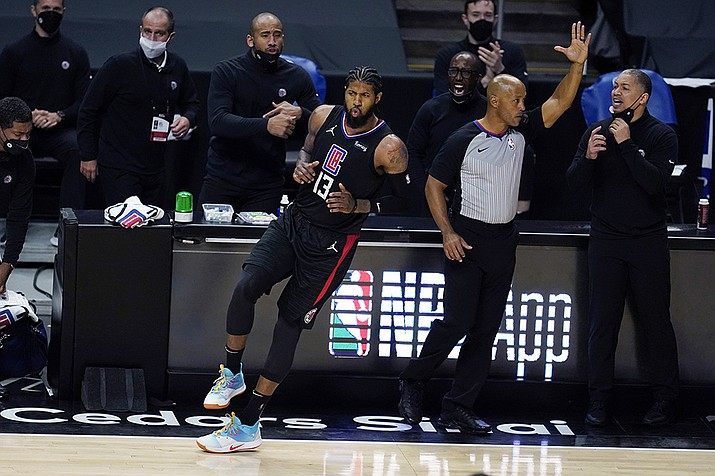 Los Angeles Clippers guard Paul George (13) reacts after making a 3-point basket during the second half of the team's NBA basketball game against the Phoenix Suns on Thursday, April 8, 2021, in Los Angeles. (Marcio Jose Sanchez/AP)