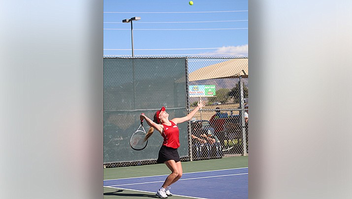 Freshman Tatum Taylor of Lee Williams High School serves during the No. 1 doubles competition at a high school tennis meet with Lake Havasu on Thursday, April 8 at Centennial Park. (Photo by Casey Jones/Kingman Miner)
