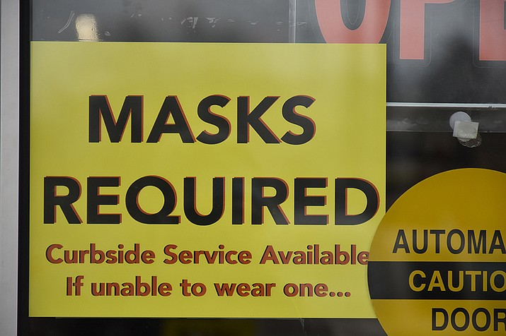 After months of improvement, COVID-19 numbers in Arizona leveled off, state officials said – not enough to be alarmed, but enough to raise concerns. And to remind people to follow health protocols like mask-wearing, despite the lack of a statewide mask mandate in Arizona. (Baker County Tourism/Creative Commons)