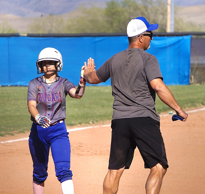 1. Chino Valley softball head coach Matt Dunn, right, celebrates with infielder Alyssa Hamm after she got a hit during a game against Camp Verde on Tuesday, April 13, 2021, in Chino Valley. The Cougars won 25-2. (Aaron Valdez/Courier)