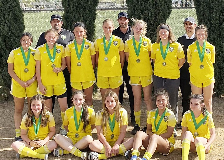 The Yavapai Soccer Club's 07 Select group of girls took first place overall in the Yavapai Cup played April 9 to April 11, 2021. The club beat Prescott Phoenix Rising 4-3 to win the title after going 3-0-1 in the tournament. From left to right in the front row: Marlee Naegle, Ciara Coleman, Lauren Page, Maria Rodriguez, Lauren Keller; Middle row, Sarah Duarte, Sydney Kroger, Evelyn Carr, Eve Gittins, Taylor Hogan, Abigail (AJ) Ingerson, Courtney Witt; Back Row, Coach Mike Ingerson, Coach Mike Carr, Coach Jacob Naegle. Not pictured is Allie Thielle, Kari Pederson and Samantha Peterson. (Michael Carr/Courtesy)