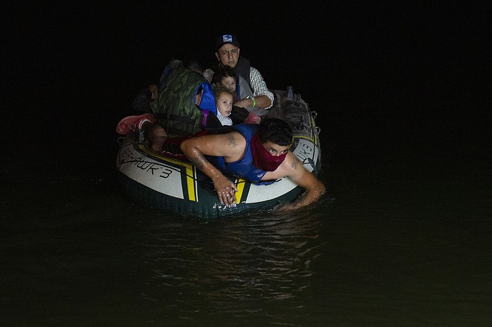 A smuggler takes migrants, mostly from Central American countries, on a small inflatable raft towards U.S. soil, in Roma, Texas March 31. Mexico President Andres Manuel Lopez Obrador said Wednesday, April 14, 2021, it was protecting human rights that was motivating Mexico's efforts to stop child migrants en route to the U.S. from being smuggled into the country. (AP Photo/Dario Lopez-Mills, File)