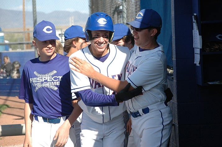 Chino Valley's Riley Roskopf celebrates in the dugout after hitting two-run home run against Camp Verde on Tuesday, April 13, 2021, in Chino Valley. (Doug Cook/Courier)