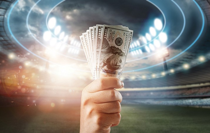 If passed, a new Arizona bill would allow betting on professional and college sports at sites owned by pro sports teams and at tribal casinos. It would also allow gambling on fantasy sports and new Keno games at horse race tracks and fraternal organizations. (Stock photo)