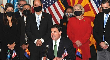 Gambling landscape changing in Arizona; governor, tribal leaders ink gaming pacts to add machines, games, casinos photo