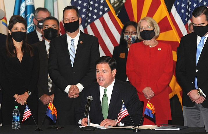 Surrounded by Arizona legislators, Gov. Doug Ducey on Thursday, April 15, 2021, explains how he believes the benefits of the new tribal gaming compacts being signed outweigh any drawbacks. (Capitol Media Services photo)
