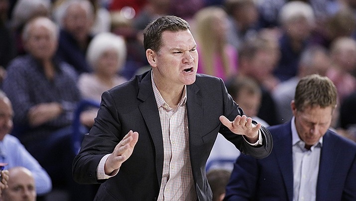 Gonzaga assistant coach Tommy Lloyd shouts to his players during the first half of an NCAA college basketball game against Texas-Arlington in Spokane, Wash., in this Tuesday, Nov. 19, 2019, file photo. Tommy Lloyd was in position to be Gonzaga's next basketball coach after Mark Few retired. A chance to coach at Arizona, one of the premier programs in the country, changed those plans. At right looking down is Mark Few. (AP Photo/Young Kwak, File)