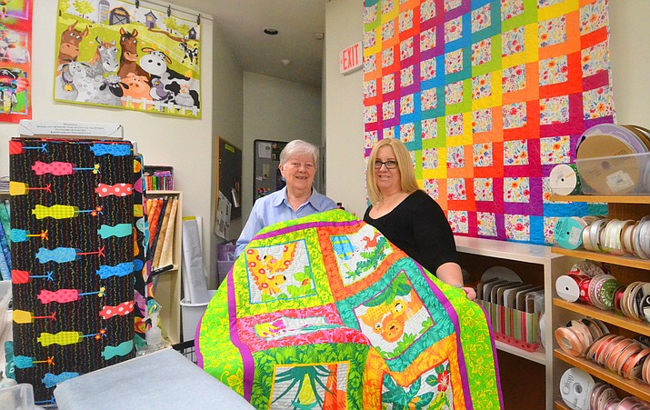 Mary Beth Groseta, left, is selling her long-time store Quilters Quarter to Melanie Korzep. VVN/Vyto Starinskas