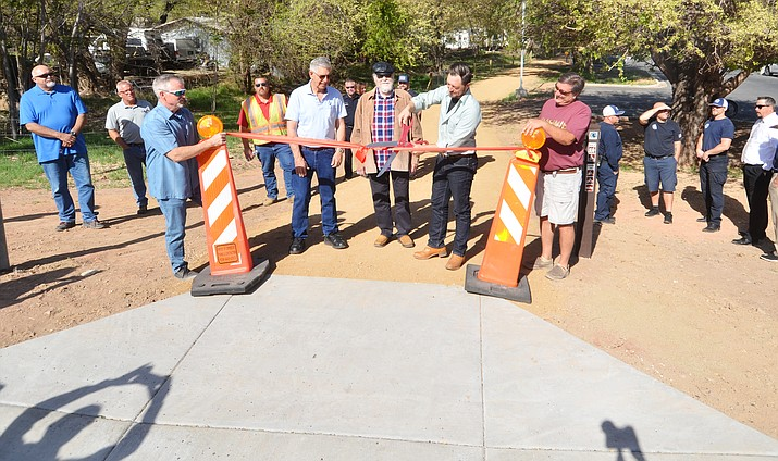 The new Riverfront Park Pedestrian Trail opened after a ribbon-cutting at the trailhead Tuesday. VVN/Vyto Starinskas