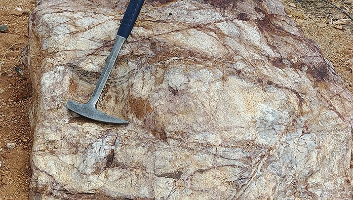 This photo shows stockwork fracturing, caused by heating of the rocks around a quartz monzonite stock, filled with iron oxide and quartz, at the Mineral Park Mine in the Cerbat Mountains. (Photo by Luis Vega/For the Miner)