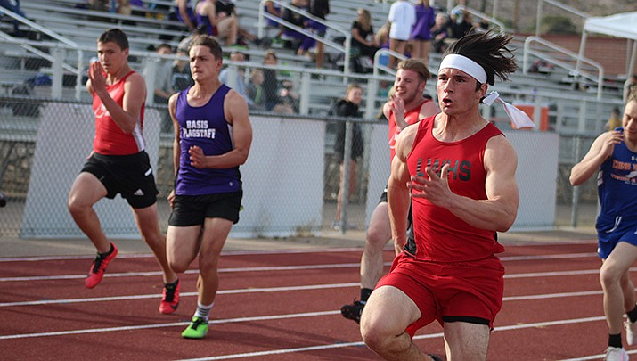 Lee Williams High School's boys track team finished second in a multi-team meet in Kingman on Wednesday, April 14. The Lee Williams girls placed third and the Kingman Academy girls were fourth. (Photo by Casey Jones/Kingman Miner)