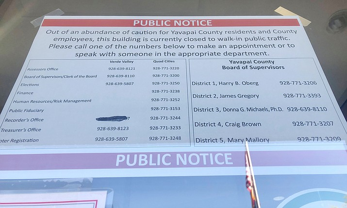 """A public notice sign was posted outside the Yavapai County Administration Building in Prescott on Monday, April 19, 2021, that reads, """"Out of an abundance of caution for Yavapai County residents and county employees, this building is currently closed to walk-in public traffic."""" On Monday, administrators received a """"threat"""" from a """"former disgruntled employee,"""" and announced a five to 10-day closure of the building. (Cindy Barks/Courier)"""