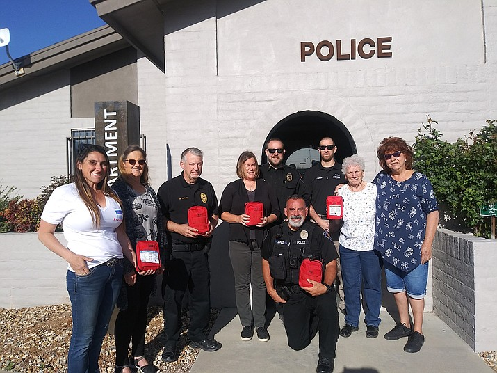 Chino Valley Police Department officers take a photo with Chino Valley Unified Schools District staff members on Wednesday, April 14, 2021, while holding trauma kits that were provided to the town's schools by the Chino Valley Police Foundation in case of an emergency on campus. (CVPD/Courtesy)