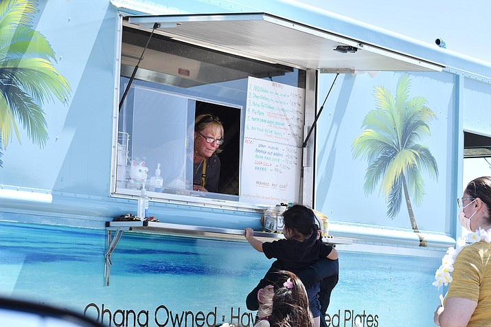 """Uncle's Hawaiian Kitchen food truck held its grand opening on Wednesday, April 14, along East First Street in Prescott Valley. The """"Ohana-owned"""" food truck offers real Kine and Hawaiian mixed plates and can be found parked near FooteWork Auto License and Title Service and near the bowling alley from noon to 2 p.m. Tuesdays, Thursdays and Saturdays every week.  (Richard Haddad/Prescott News Network)"""