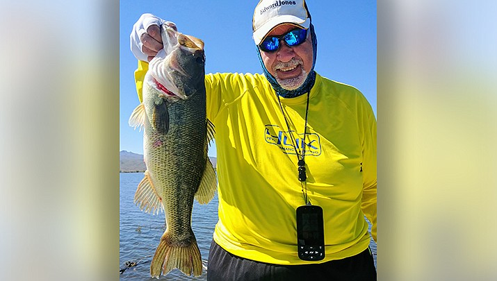 Bill Schleeter of Golden Valley displays a largemouth bass he caught at Alamo Lake in La Paz County, a destination for many Kingman-area anglers. (Photo by Don Martin/For the Miner)