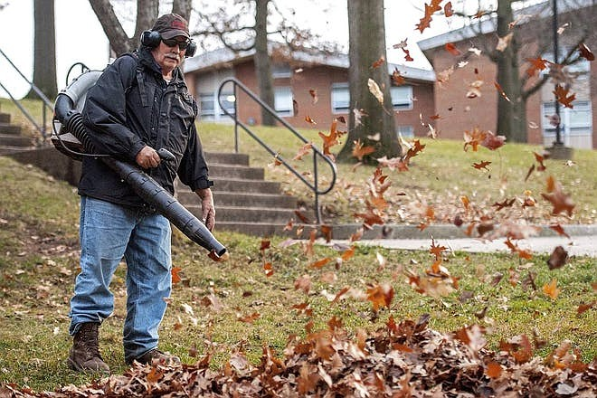 Gas-powered blowers operate at 90 decibels, which can cause hearing damage after two hours of exposure, according to the U.S. Centers for Disease Control and Prevention. Vermont's largest city is banning the use of loud, gas-powered leaf blowers. (Austin Bachand, Associated Press)