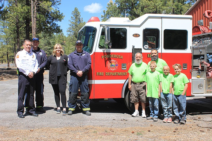 Ponderosa Fire District participated in the 2021 Spring Fling Craft Fair and Expo April 10 at the Parks Feed and Mercantile. The Coconino County Sheriff's Office also met with the community. Eagle Event Planners hosted the event which raised $750 for the Ponderosa Fire District employee support fund. Above: Chief Lee Antonides, Lieutenant Mike Allen, Captain Chris Jeffers and Morgan Owens pose with Jeff, Alvin, Skylyr, James and Joey Miller of Eagle Event Planners.