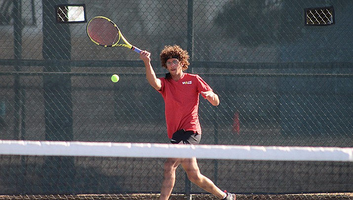 Kohen Juelfs, a junior at Lee Williams High School, returns a shot against Brandon Lloyd of Estrella Foothills in the No. 2 singles match on Monday, April 19 at Centennial Park. Juels won 6-2, 6-3. (Photo by Casey Jones/Kingman Miner)