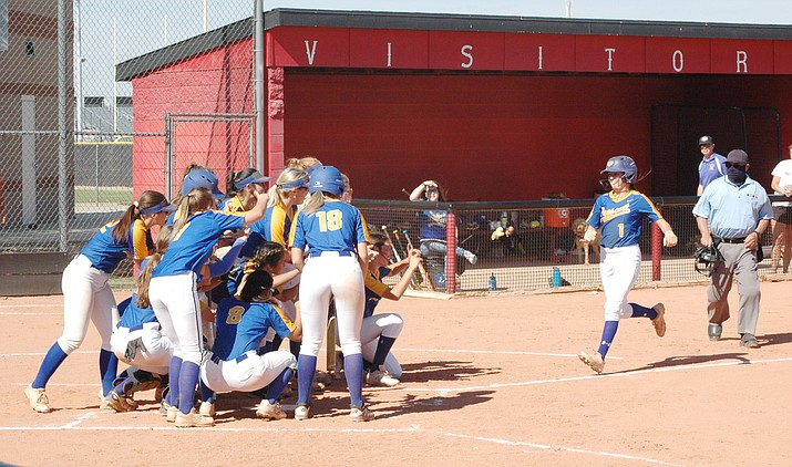 Prescott's Dana Seavey gets ready to cross home plate with her teammates ready to celebrate after she hits a home run against rival Bradshaw Mountain in the third inning Tuesday, April 20, 2021, in Prescott Valley. (Doug Cook/Courier)