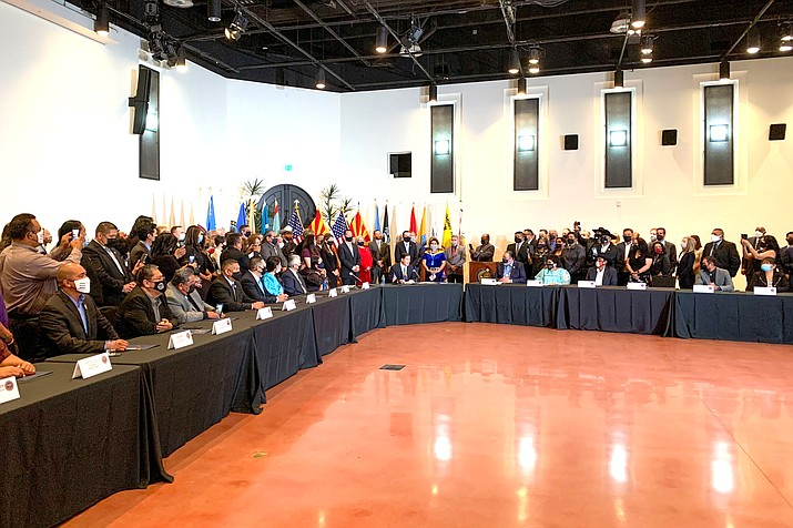 Tribal leaders and members were present for the signing of House Bill 2772 and the amended Tribal-State Gaming Compact by Gov. Doug Ducey.. (Photo/Alina Nelson, Cronkite News)