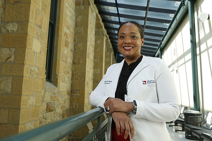 """Dr. Mysheika W. Roberts, the health commissioner for Columbus Public Health, poses for a portrait in Columbus, Ohio, on Wednesday, April 14, 2021. Public health officials who have juggled bare-bones budgets for years are happy to have the additional money prompted by the COVID-19 pandemic. Yet they worry it will soon dry up as the pandemic recedes, continuing a boom-bust funding cycle that has plagued the U.S. public health system for decades. If budgets are slashed again, they warn, that could leave the nation where it was before covid: unprepared for a health crisis. """"We need funds that we can depend on year after year,"""" says Roberts. (AP Photo/Paul Vernon/AP)"""