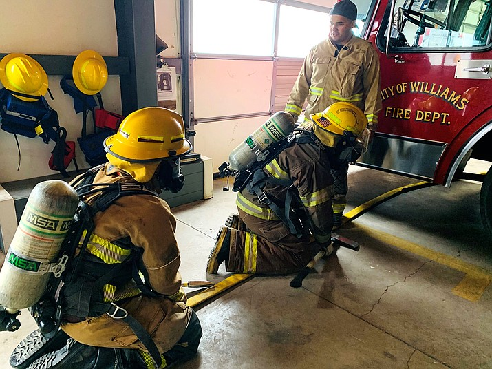 Williams Volunteer Fire Department recruits receive instruction during a black out drill at Station 2 in Williams. Recruit training is expected to be complete in April. (Photo/Williams Volunteer Fire Department)