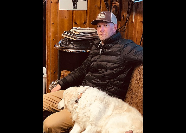 """In this photo provided by Jerry D. Johnson, Charles """"Carl"""" Mock is seen in an undated photo inside the offices of Backcountry Adventures, a guided snowmobile tour company that he worked at in West Yellowstone, Mont. Mock died over the weekend after being mauled by a grizzly bear just outside Yellowstone National Park. (Jerry D. Johnson via AP)"""