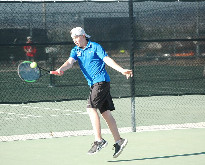 Prescott tennis player Leyton Fetty returns a shot Wednesday, April 21, 2021, as the Badgers took on rival Bradshaw Mountain in Prescott Valley. (Doug Cook/Courier)