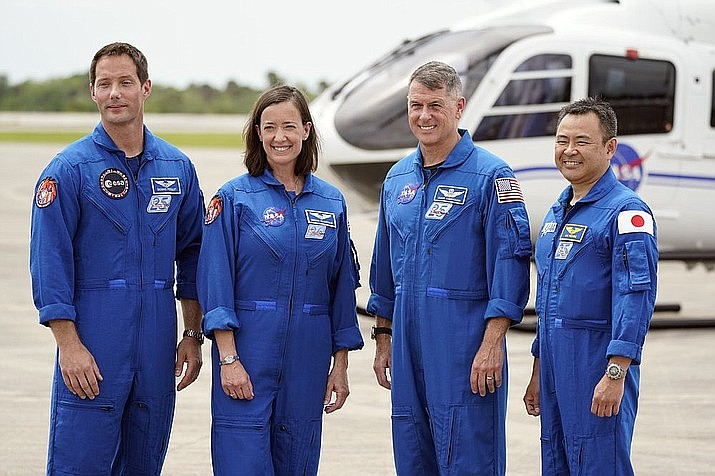 SpaceX Crew 2 members, from left, European Space Agency astronaut Thomas Pesquet, NASA astronauts Megan McArthur and Shane Kimbrough and Japan Aerospace Exploration Agency astronaut Akihiko Hoshide gather at the Kennedy Space Center in Cape Canaveral, Fla., Friday, April 16. (AP Photo/John Raoux)