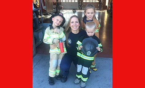 After giving birth to her first child, Phoenix Fire Capt. Nicole Minnick participated in a study to examine the effects of firefighting on breastfeeding. She has three children: daughter Kyndal, 12, and sons, Kemper, 11, and Taylor, 9. (Photo courtesy of Nicole Minnick)