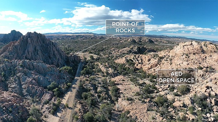 """This undated image shows drone footage of the Dells area in Prescott, with the """"Point of Rocks"""" on the left, and AED open space on the right. This past week, the City of Prescott announced the proposed development agreement with Arizona Eco Development will be released to the public Tuesday, June 8, 2021. (Courier file photo)"""