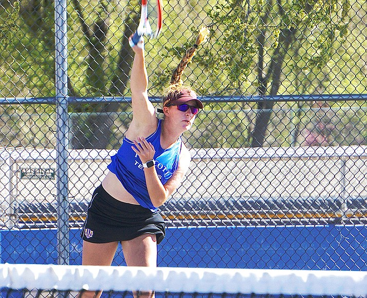 Prescott tennis' Ava Andrews hits a serve during a doubles match against Bradshaw Mountain on Wednesday, April 21, 2021, in Prescott. The Badgers defeated the Bears 8-1. (Aaron Valdez/Courier)