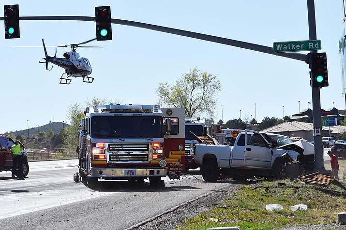 A helicopter takes off Wednesday, April 21, 2021, after a multi-vehicle accident on Highway 69 and Walker Road near Prescott. (Richard Haddad/Courier)