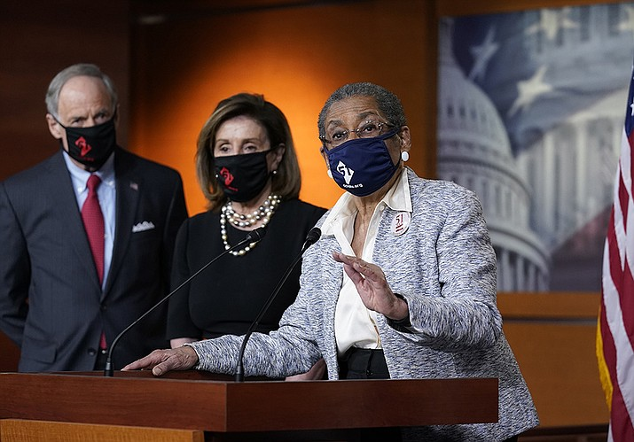 In this April 21, 2021, photo, Del. Eleanor Holmes-Norton, D-D.C., center, joined from left by Sen. Tom Carper, D-Del., and House Speaker Nancy Pelosi, D-Calif., speaks at a news conference ahead of the House vote on H.R. 51- the Washington, D.C. Admission Act, on Capitol Hill in Washington (J. Scott Applewhite/AP)