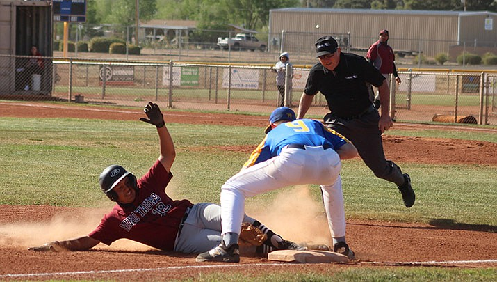 Freshman Caleb McCray of Kingman High School tags out Odyssey Insitute runner  Antonio Torres at third base on Tuesday, April 20. Kingman lost 5-1 to the second-ranked Minotaurs. (Photo by Casey Jones/Kingman Miner)