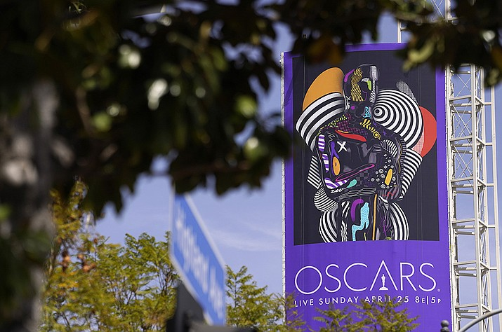 A sign advertising this year's Oscars ceremony is pictured near the Dolby Theatre, Thursday, April 15, 2021, in Los Angeles. The Dolby Theatre is one of the locations being used for the 93rd Academy Awards on Sunday, April 25. (Chris Pizzello/AP)