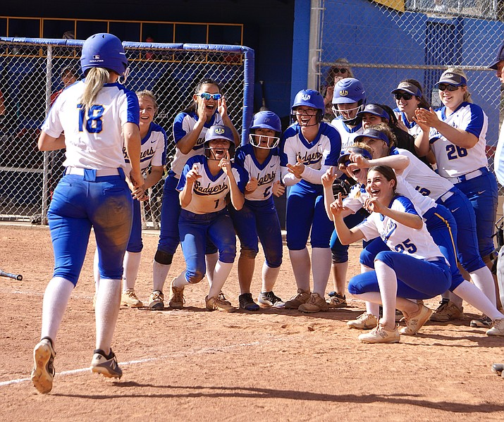 The Prescott softball team waits at home plate to greet infielder Kennedy Carr after she hit a home run during a game against Bradshaw Mountain on Thursday, April 22, 2021, in Prescott. The Badgers defeated the Bears 21-5. (Aaron Valdez/Courier)