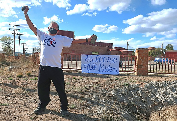 Tim Lewis, an artist from St. Michaels, Arizona, stands alongside a road in Window Rock, Arizona, hoping to get a glimpse of First Lady Jill Biden as she visited the Navajo Nation April 22, 2021. The trip is Biden's third to the vast reservation that stretches into Arizona, New Mexico and Utah. (AP Photo/Felicia Fonseca)