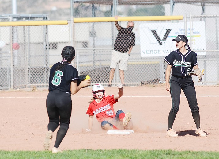 Mingus Union junior Alexis Ayersman slides into second base in Wednesday's thrilling Marauder win over Greenway. Ayersman hit a game-ending, 12th-inning homerun to break a scoreless tie after striking out 23 batters as the Marauders' pitcher. VVN/Vyto Starinskas
