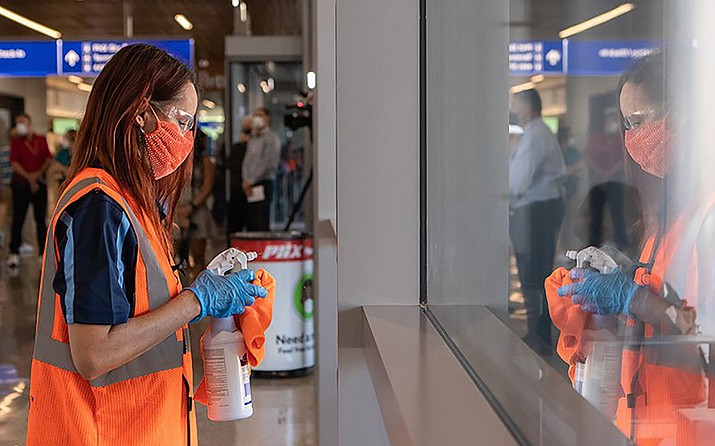 Since the start of the COVID-19 pandemic, workers have stepped up cleaning and sanitizing of windows and surfaces at Sky Harbor. (File photo by Allie Barton/Cronkite News)