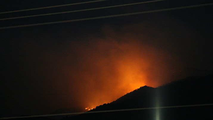 The Flag Fire lights the sky in the Haualapai Mountains the evening of Sunday, April 25. The fire had burned about 1,400-acres by the morning of Monday, April 26. (Courtesy photo by Samuel Rhine)