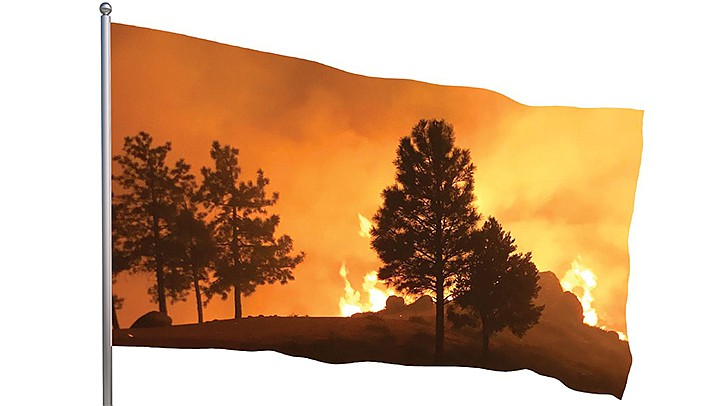 This photo by the Bureau of Land Management shows the Flag Fire burning in the Hualapai Mountains.
