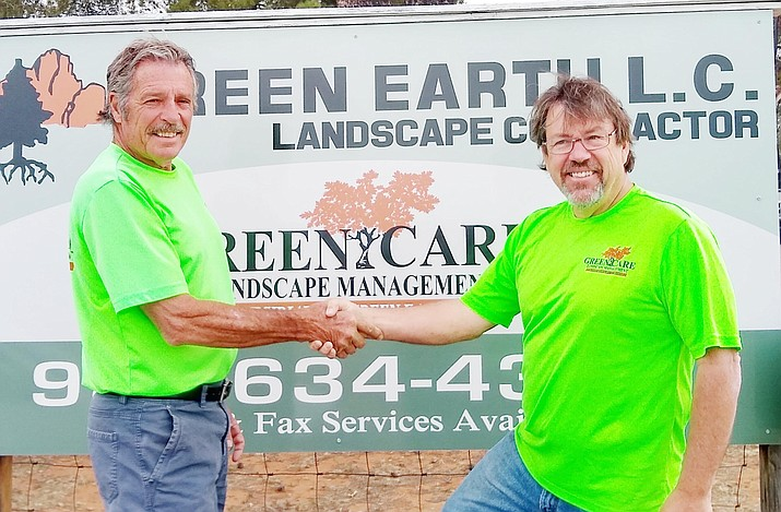 David J. Grondin, left, shakes hands with new owner Paul Comstock of Green Earth. Comstock said he is looking to expand the maintenance side of the business. Green Earth, based in Cornville, which currently has 16 employees. Courtesy of Green Earth